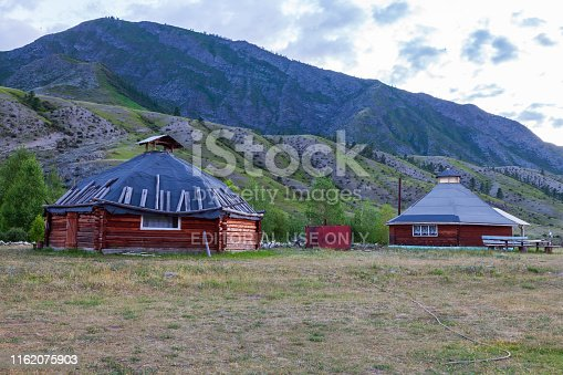 istock The ancient antique ail house from wood is round-shaped with a chimney on top of the center, for the nomadic indigenous people in the Altai Mountains with green trees and picturesque scenery. 1162075903