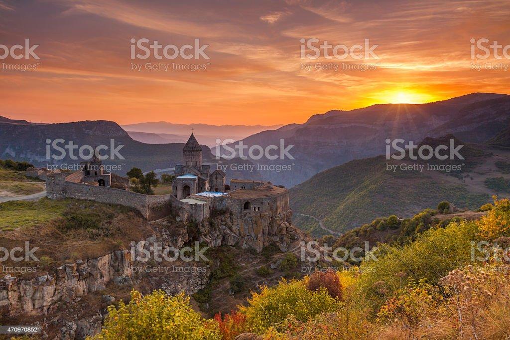 The ancient monastery in the setting sun. Tatev. Armenia. stock photo