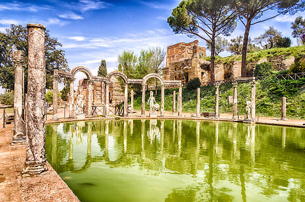 The Ancient Pool called Canopus in Villa Adriana (Hadrian's Vill The Ancient Pool called Canopus, surrounded by greek sculptures in Villa Adriana (Hadrian's Villa), Tivoli, Italy lazio stock pictures, royalty-free photos & images