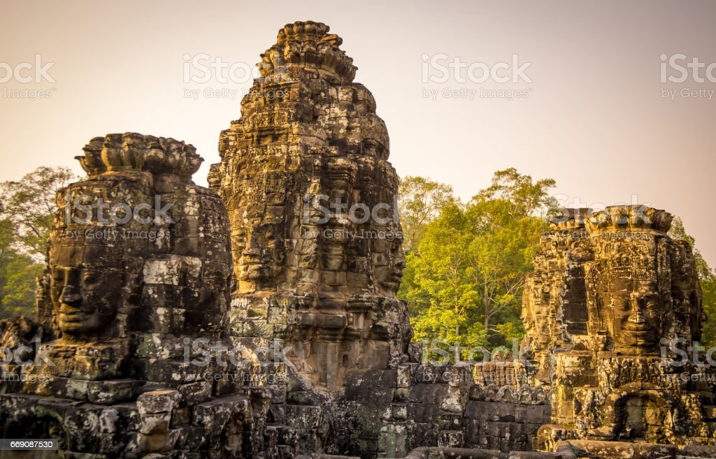 The ancient temple ruins with faces of Angkor, Cambodia stock photo