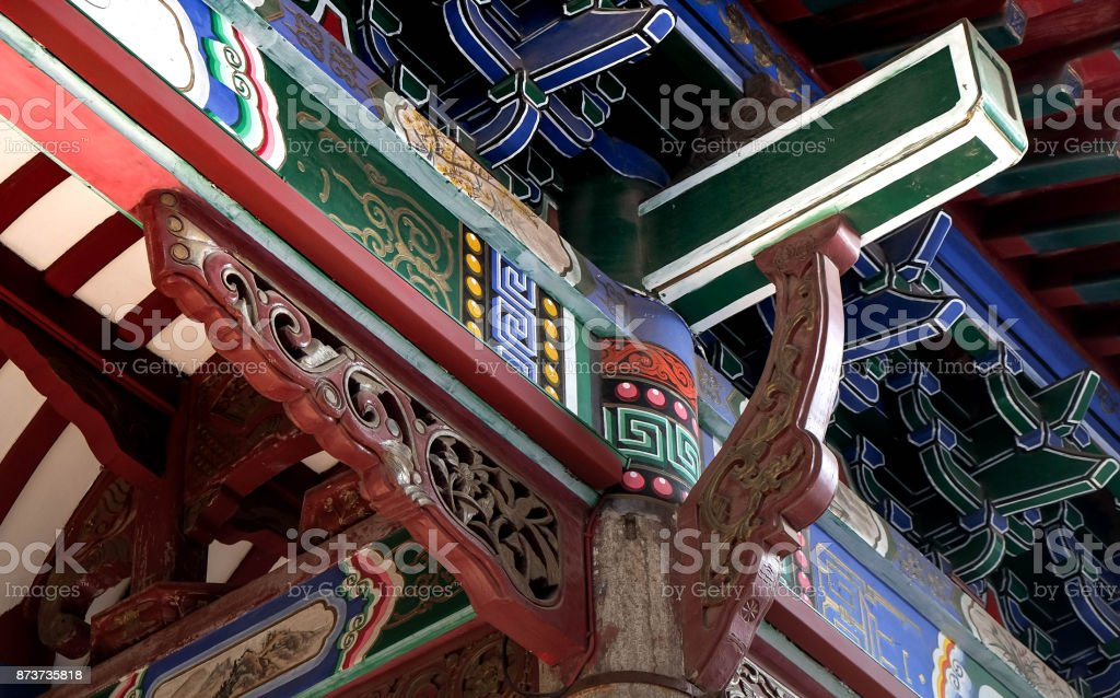 The ancient tile roof and decorate with the lotus line located in the temple stock photo