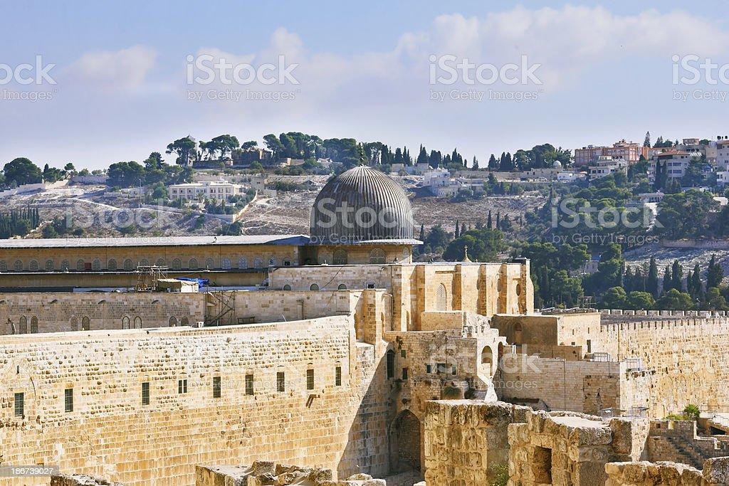 The ancient walls of Jerusalem, lit morning sun. stock photo