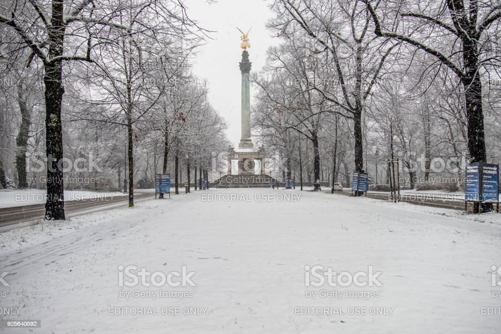 The Angel of Peace on the top of Friedensengel monument in Munich, Germany during the snow srorm stock photo