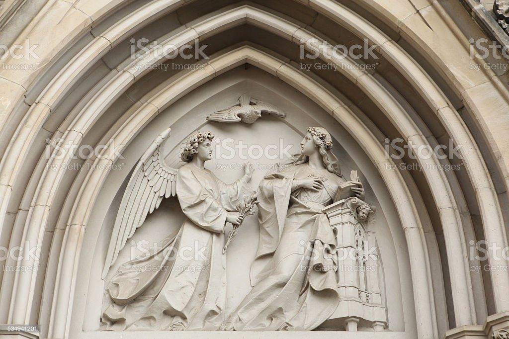 The Annunciation. Gothic relief in Olomouc, Czech Republic. stock photo