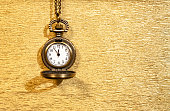 istock The antique clock shows almost midnight on a sparkling gold background. New year concept. 1277343651
