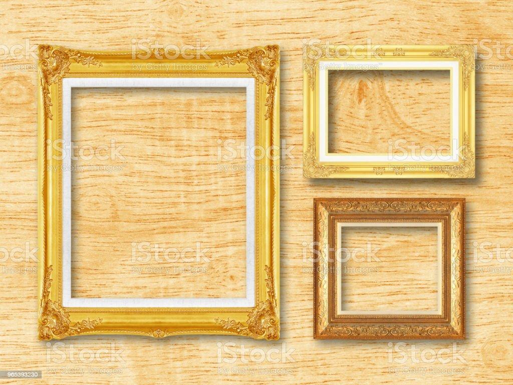 The antique gold frame on wooden l background zbiór zdjęć royalty-free