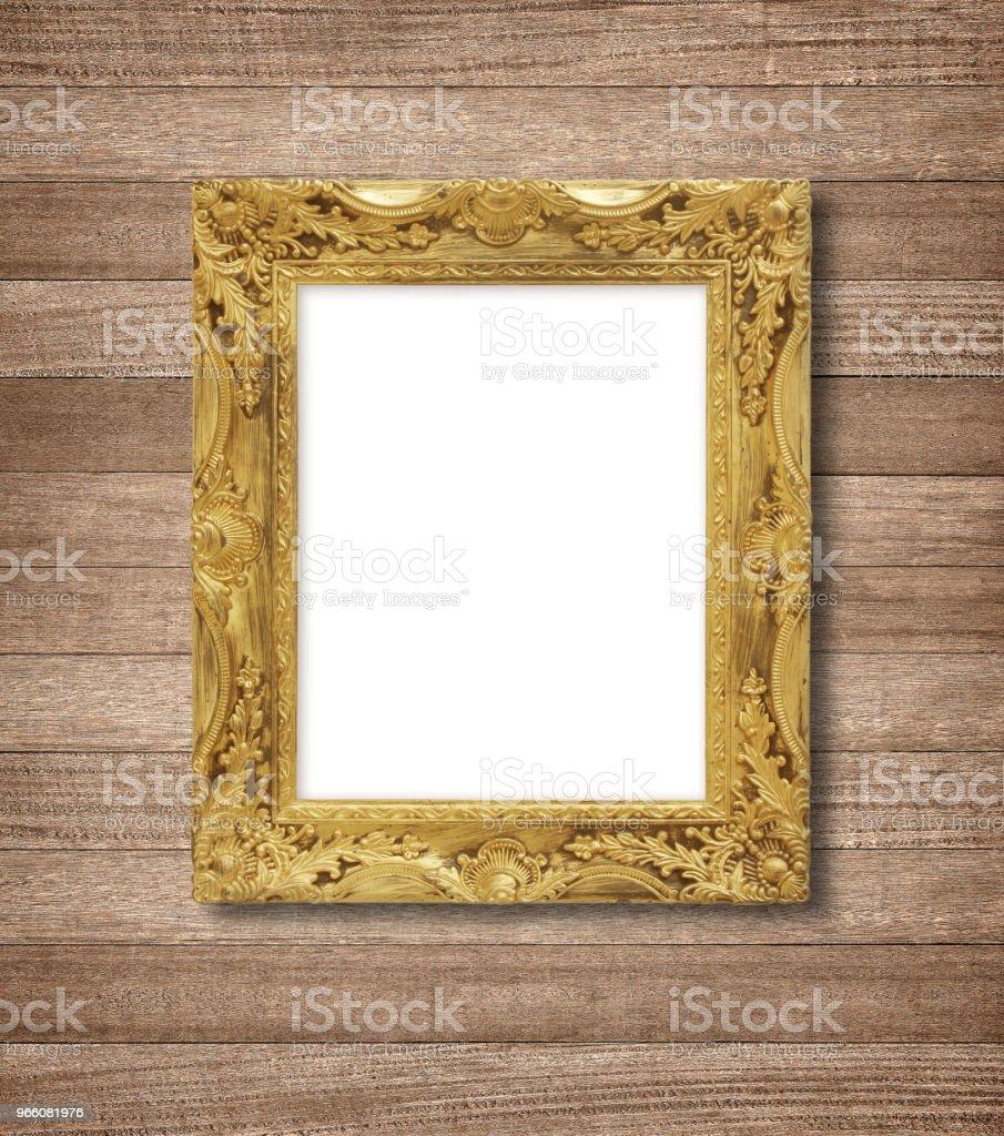 Den antika guld ram på trävägg - Royaltyfri Antik Bildbanksbilder