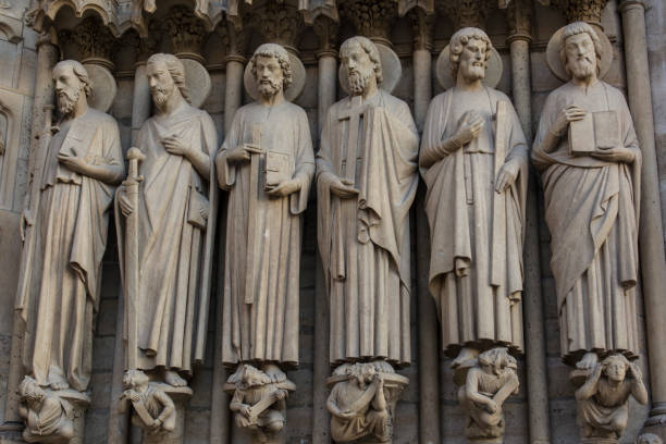 The apostles of Jesus Christ 6 Sculptures  of the twelve apostles of Jesus on the facade of Notre Dame of Paris religious saint stock pictures, royalty-free photos & images