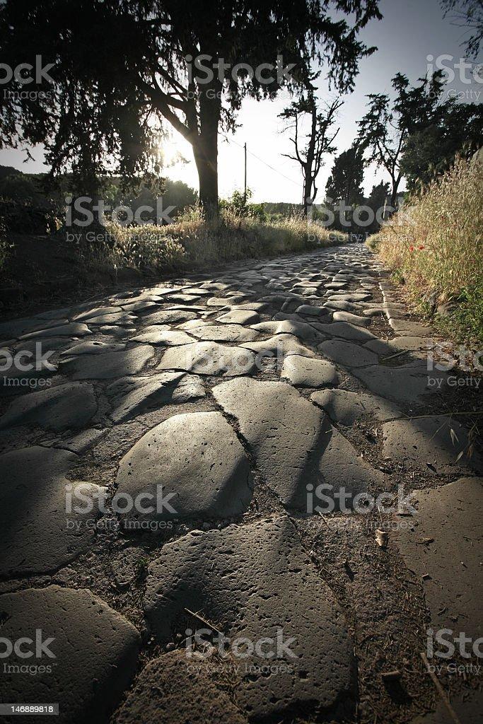Il Appian way a Roma al tramonto - foto stock