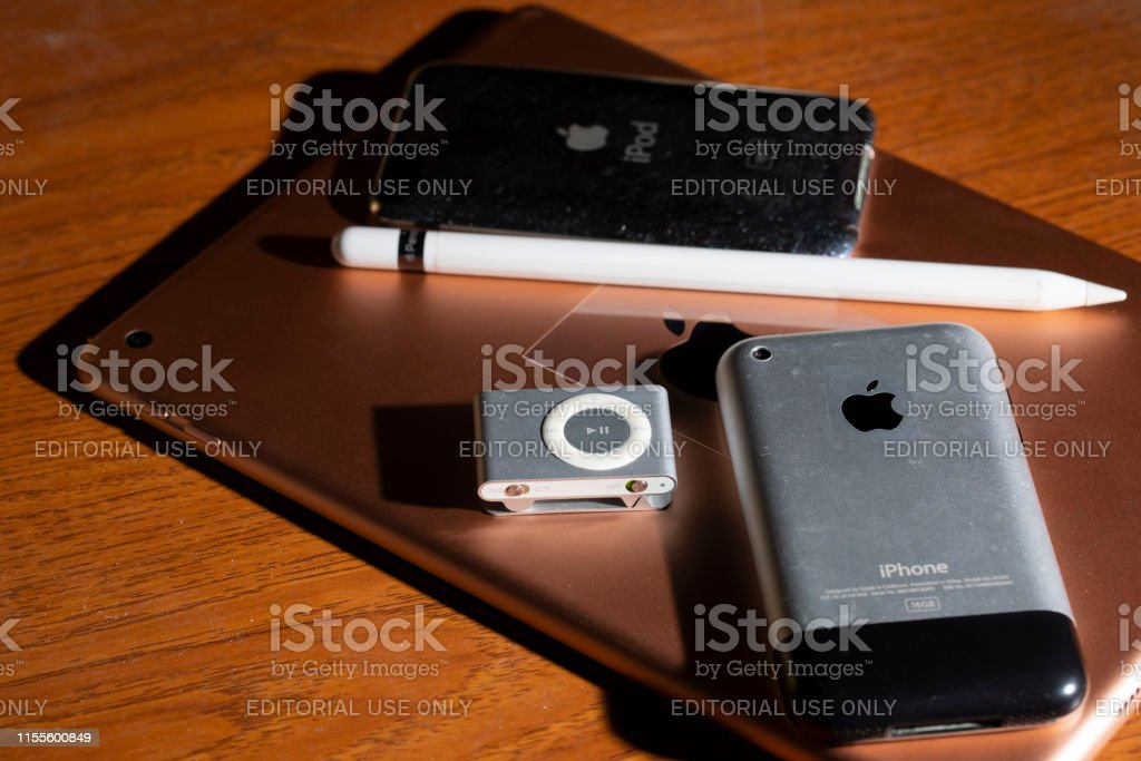iPad and Apple pencil with iPhone 2G, iPod shuffle and iPod 2Gen on...
