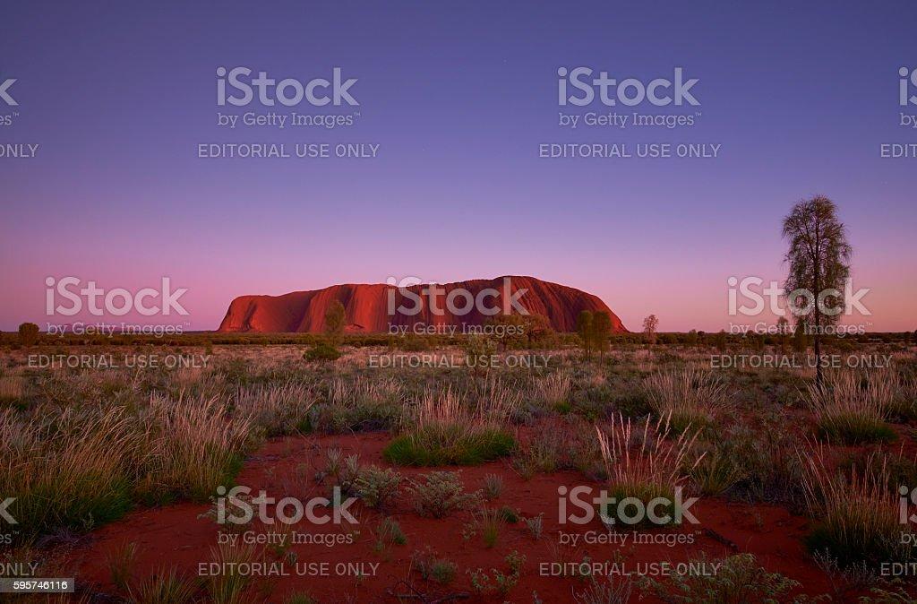 The Approaching Dawn And Uluru stock photo