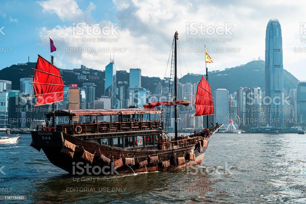 The Aqua Luna sail around Victoria Harbour, Hong Kong Hong Kong - July 26, 2019: The Aqua Luna sail around Victoria Harbour. Cheung Po Tsai was a 19th-century Chinese pirate. Architecture Stock Photo