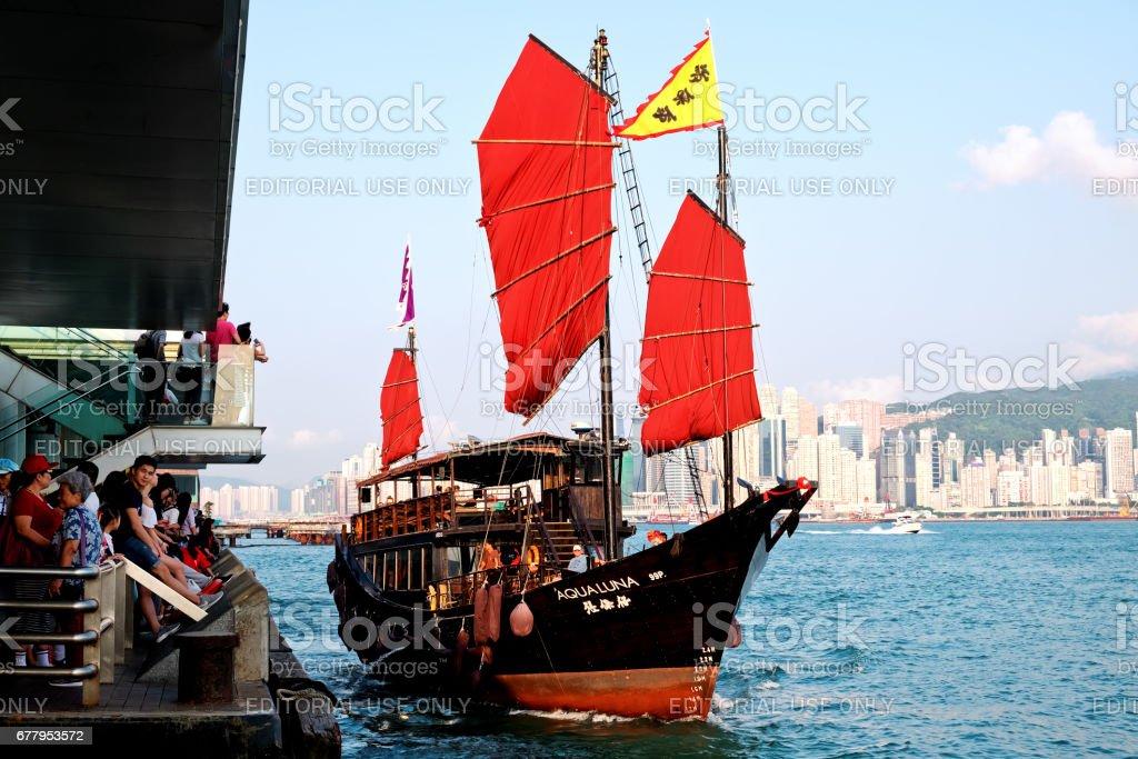 The Aqua Luna sail around Victoria Harbour Hong Kong HONG KONG, Tsim Sha Tsui - May 01, 2017 : The Aqua Luna sail around Victoria Harbour Hong Kong. Cheung Po Tsai was a 19th-century Chinese pirate. Architecture Stock Photo