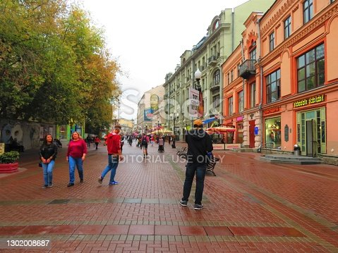 Moscow, Russia - September 05, 2019. People walking at the Arbat Street, a pedestrian zone in the historical centre of city.Arbat Street is a pedestrian street about one kilometer long in the historical centre of Moscow, Russia. The Arbat has existed since at least the 15th century, which makes it one of the oldest surviving streets of the Russian capital.