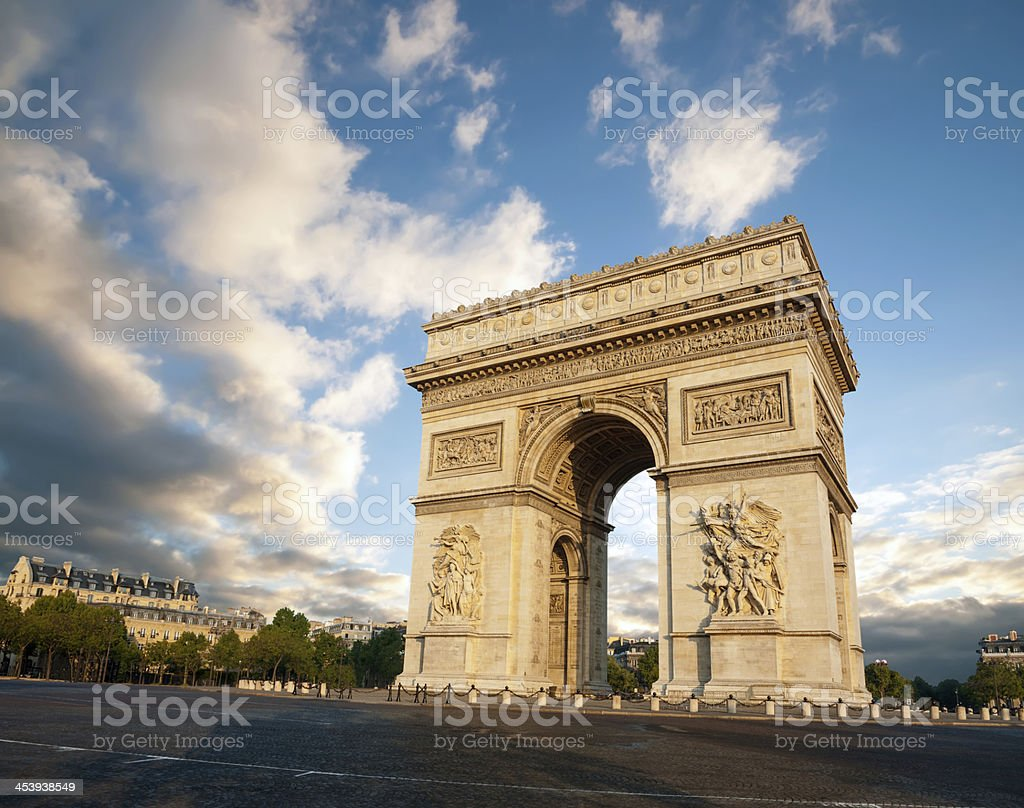 The Arc de Triomphe with blue sky and back around stock photo