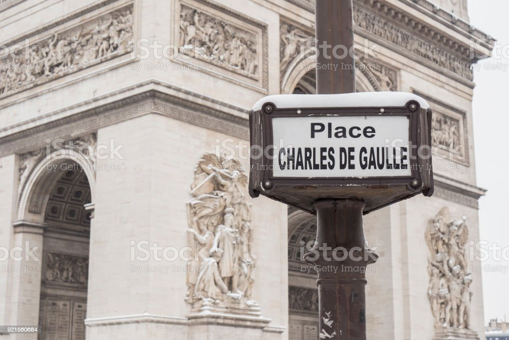 The arc de triumph by a rare snowy day in Paris, France stock photo