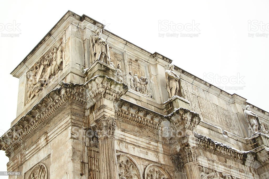 The Arch of Constantine covered by snow royalty-free stock photo