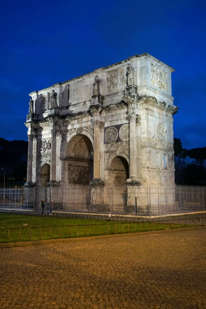 The Arch of Constantine in Rome The Arch of Constantine (Italian: Arco di Costantino) is a triumphal arch in Rome, Italy located between the Colosseum and the Palatine Hill. palatine hill rome stock pictures, royalty-free photos & images