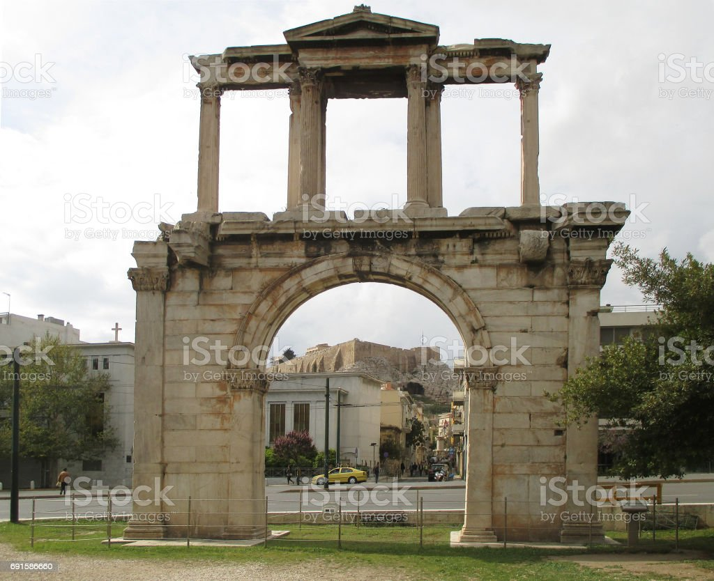The Arch of Hadrian or Hadrian's Gate with the Acropolis of Athens in the Background, Athens stock photo