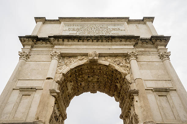 The Arch of Titus in Rome The Arch of Titus located in the Roman Forum, commemorating Titus' victories in war. palatine hill rome stock pictures, royalty-free photos & images