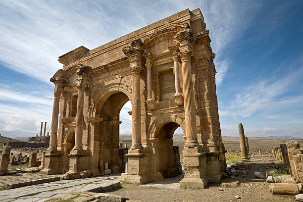 the arch of trajan - algeria stock photos and pictures
