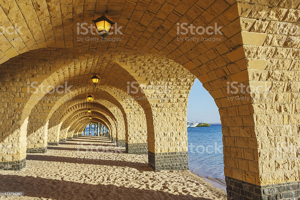 The arched stone colonnade with lanterns royalty-free stock photo