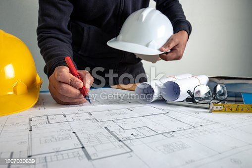 istock The architect is working to design the building at the office desk. 1207030639