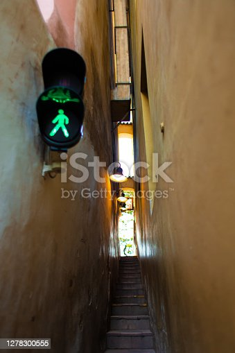 istock The architecture of the strago city of Prague. The narrowest street in Europe. The passage between buildings for one person, regulated by traffic lights 1278300555