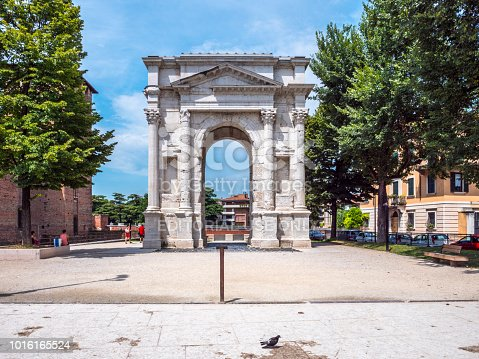 people near Arco dei Gavi in Verona city in spring. Arch was built in the second half of the first century, in 1930 the arch was restored from the preserved material