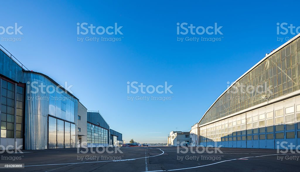 The area between aircraft hangars stock photo