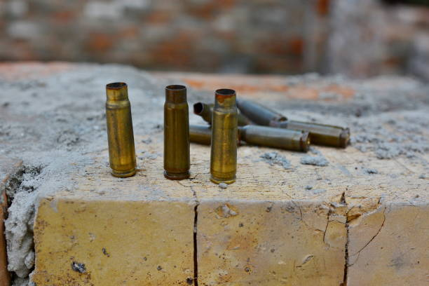 UKRAINE: The area of the anti-terrorist operation DONETSK REGION, UKRAINE - 29 JUNE 2020: Empty machine gun cartridges on a brick wall in the area of the anti-terrorist operation antiterrorist stock pictures, royalty-free photos & images