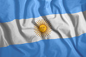 The Argentine flag flies in the wind. Colorful national flag of Argentina. Patriotism, patriotic symbol.