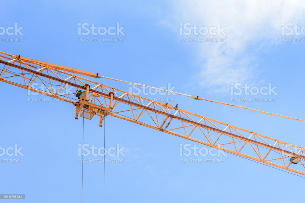 The arm of construction crane stock photo