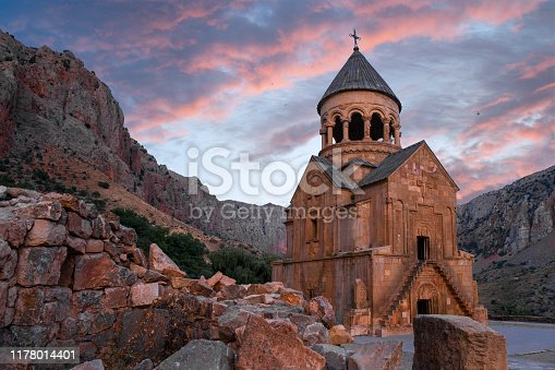 the Armenian monastery of Noravank in the evening with a troubled sky
