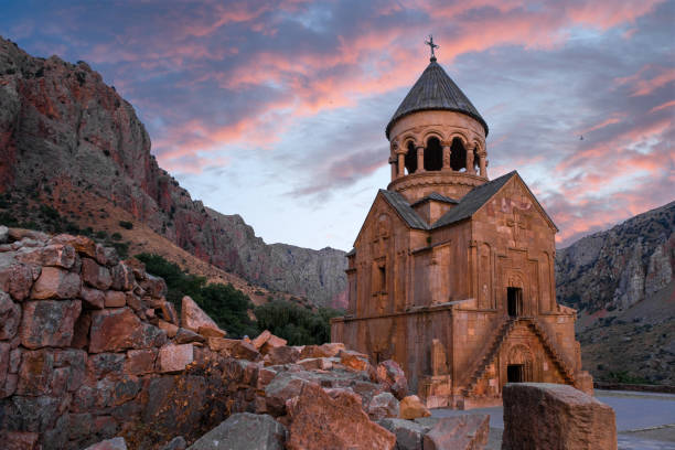 the Armenian monastery of Noravank the Armenian monastery of Noravank in the evening with a troubled sky monastery stock pictures, royalty-free photos & images
