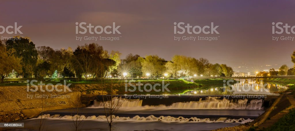 The Arno River flowing through Florence at sunrise.Italy royalty-free stock photo