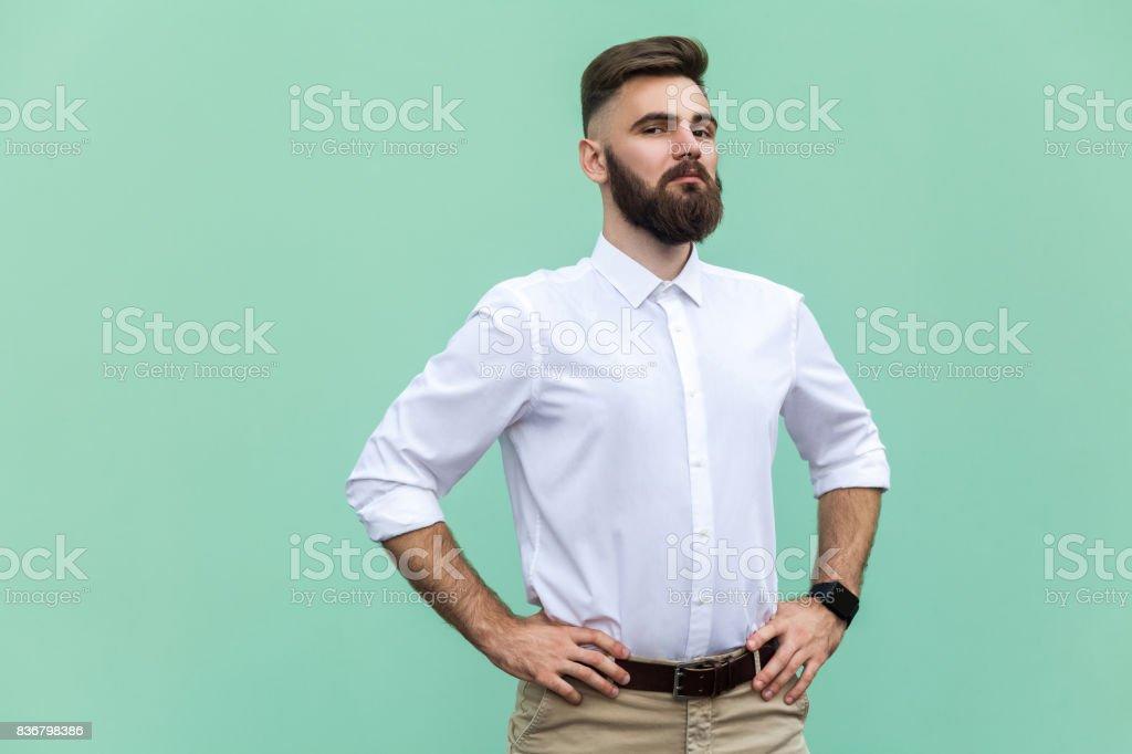 The arrogant bearded man. Businessman looking at camera. Indoor, stock photo