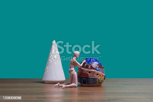 Green Background, Human Figure, Model House, Triangle Lantern, Wooden Table,