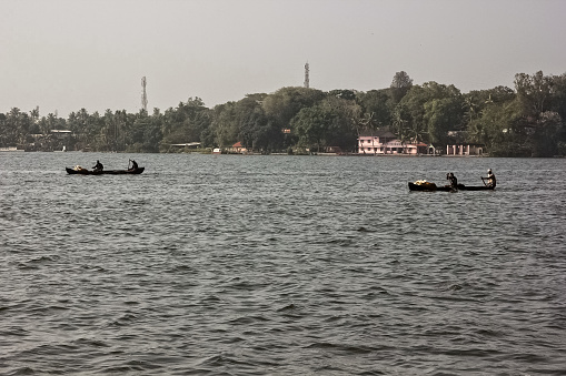Kollam, Kerala, India - January 2014: The tranquil waters of the Ashtamudi lake in the town of Quilon.
