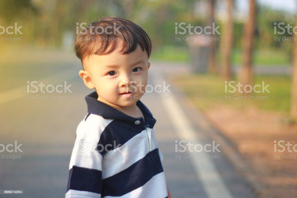 The asian boy is resting in the park. stock photo