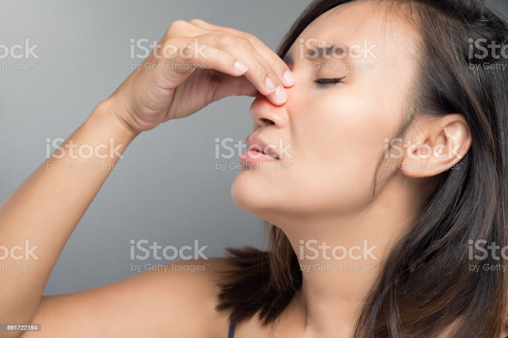 The asian woman hurts her nose because she has cold. stock photo