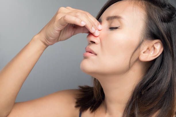 The asian woman hurts her nose because she has cold. The asian woman hurts her nose because she has cold. polyp corals stock pictures, royalty-free photos & images