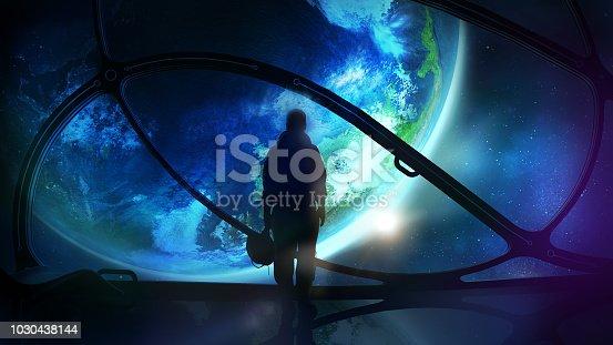 istock The astronaut looks at the globe 1030438144