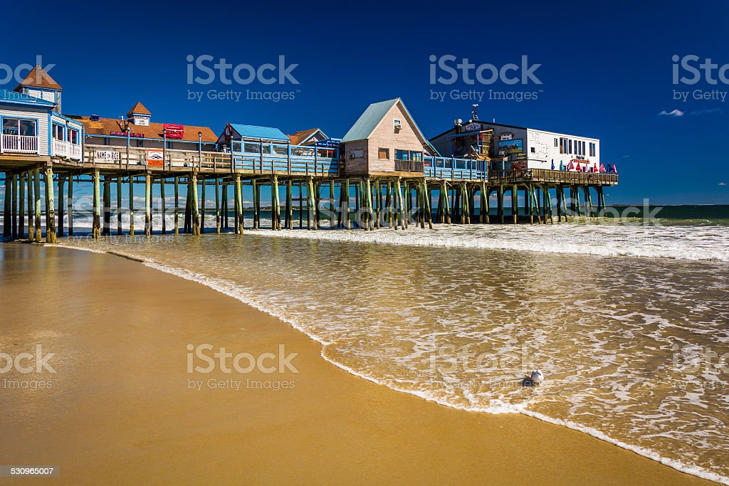 The Atlantic Ocean and pier in Old Orchard Beach, Maine. stock photo