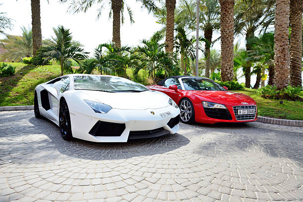 The Atlantis the Palm hotel and luxury sport cars Dubai, UAE - September 11, 2013: The Atlantis the Palm hotel and luxury sport cars. It is located on man-made island Palm Jumeirah. luxury car stock pictures, royalty-free photos & images