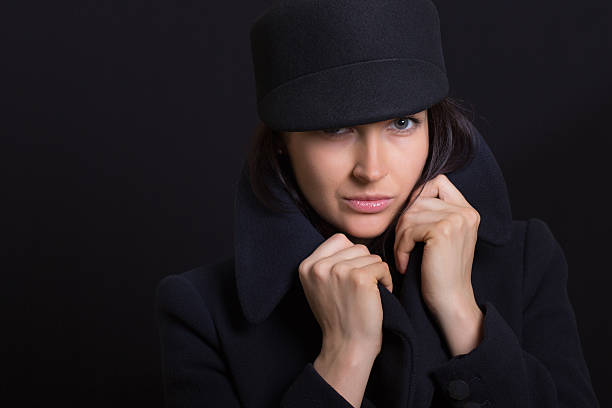 the attractive woman in a cap stock photo
