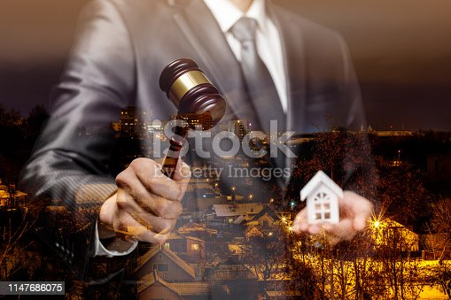 istock The auctioneer conducts the auction for the sale of real estate . 1147686075