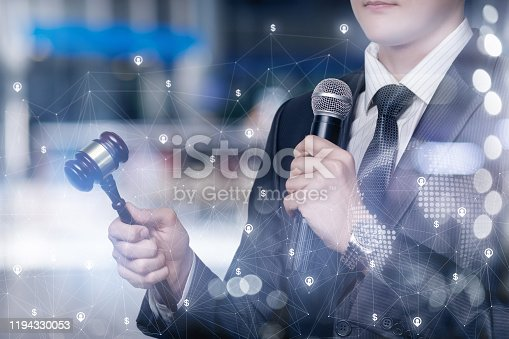 1050485096 istock photo The auctioneer conducts the auction online. 1194330053