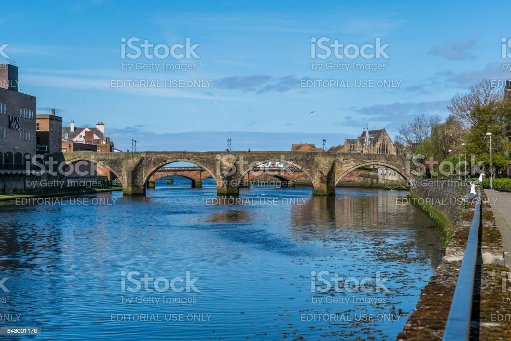 The Auld Brig of Ayr, the River Ayr and seagulls. stock photo