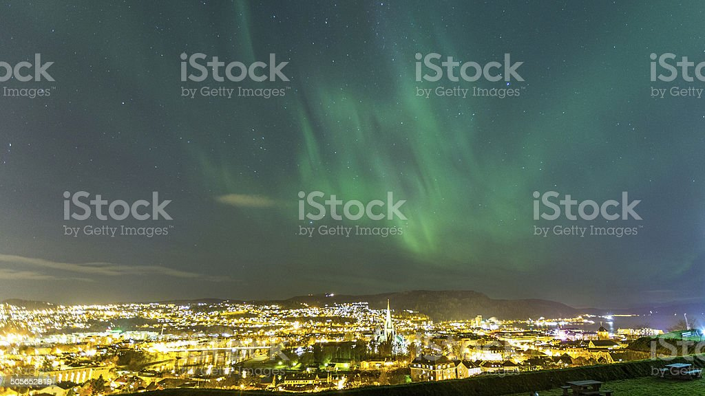 The Aurora above the city stock photo